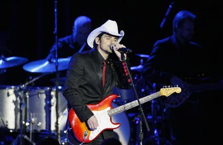 Country music singer Brad Paisley performs at the Commander in Chief's Ball during presidential inauguration ceremonies in Washington, January 21, 2013. REUTERS/Rick Wilking
