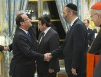 French President Francois Hollande (L) greets the Grand Rabbi of France Gilles Bernheim before delivering his New Years speech to French religious leaders at the Elysee Palace in Paris, January 8, 2013. REUTERS/Jacques Brinon/Pool