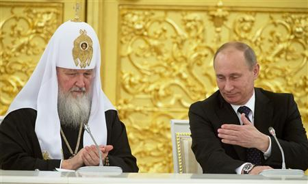 Russia's President Vladimir Putin (R) and Patriarch of Moscow and All Russia Kirill attend a meeting with Russian Orthodox church bishops in Moscow February 1, 2013, in this picture provided by Ria Novosti. REUTERS/Sergei Gunyeev/Ria Novosti/Pool