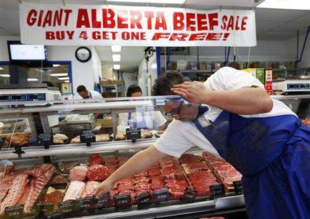 Clayton Colliou, a butcher at Bon Ton Meat Market, organizes choice cuts of Alberta beef in Calgary, Alberta, October 3, 2012. REUTERS/Todd Korol