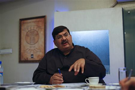 Aqeel Karim Dhedhi, Chairman of AKD Securities Ltd, speaks during an interview with Reuters at his office in Karachi January 31, 2013. REUTERS-Akhtar Soomro