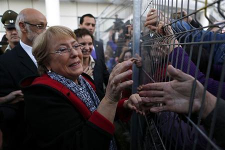 Former Chilean president and former executive director of gender equality body U.N. Women Michelle Bachelet is welcomed by her supporters upon her arrival at Santiago airport March 27, 2013. REUTERS/Ivan Alvarado