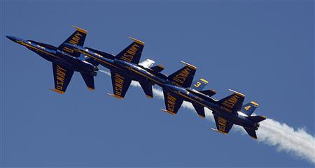 Members of the U.S. Navy Blue Angels perform during the Andrews Air Show at Joint Base Andrews, Maryland in this May 19, 2012 file photo. REUTERS/Stelios Varias/Files