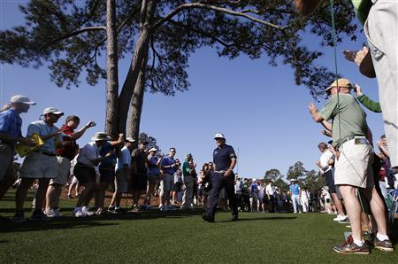 Phil Mickelson of the U.S. is applauded as he walks to the eighth tee during a practice round in preparation for the 2013 Masters golf tournament at the Augusta National Golf Club in Augusta, Georgia, April 9, 2013. REUTERS/Mike Segar