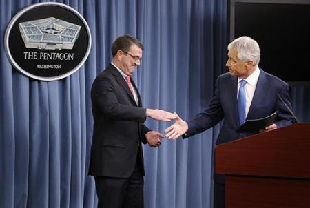 U.S. Secretary of Defense Chuck Hagel (R) shakes hands with Deputy Secretary of Defense Ash Carter as he departs a news conference about the effects of the 'sequester' on military operations, at the Pentagon in Arlington, Virginia, March 1, 2013. REUTERS/Jonathan Ernst