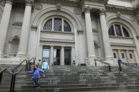 Children run down the stairs of The Metropolitan Museum of Art in New York October 29, 2012. REUTERS/Carlo Allegri