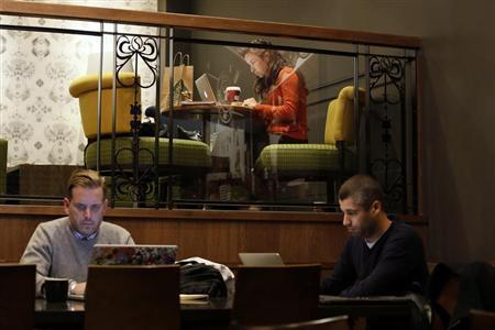 Customers use laptop computers in Starbucks' Vigo Street branch in Mayfair, central London January 11, 2013. REUTERS/Stefan Wermuth
