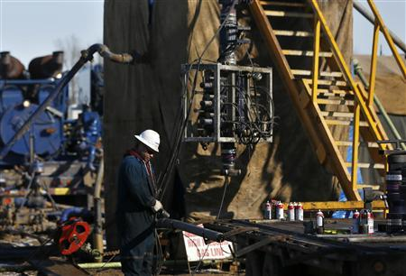 A man works at an oil fracking pump site in McKenzie County outside of Williston, North Dakota March 12, 2013. REUTERS/Shannon Stapleton
