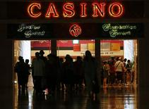 Guests leave the lobby area of the Sentosa Resorts World Casino in Singapore April 8, 2013. High-rollers get lavish treatment and hefty credit lines at Singapore's two casinos, like any other gaming house in the world. But here, more of them skip town without paying their debt, a matter of increasing concern for investors. REUTERS/Edgar Su