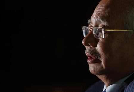 Malaysia's Prime Minister Najib Razak speaks to Reuters at his office in Putrajaya outside Kuala Lumpur March 26, 2013. REUTERS/Bazuki Muhammad