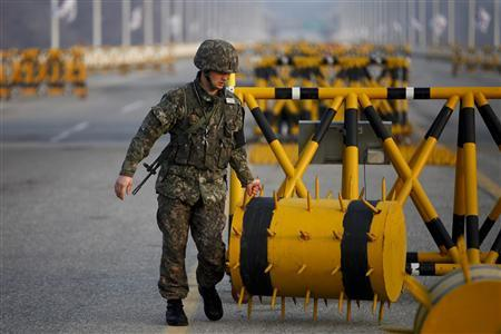A South Korean soldier sets up a barricade at a checkpoint on the Grand Unification Bridge, which leads to the demilitarized zone separating North Korea from South Korea, in Paju, north of Seoul April 8, 2013. REUTERS/Kim Hong-Ji