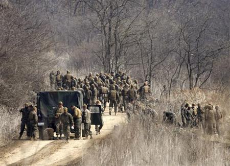 U.S. soldiers arrive for their military training near the demilitarized zone (DMZ) separating North Korea from South Korea in Paju, north of Seoul April 8, 2013. REUTERS/Lee Jae-Won