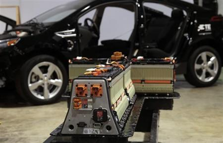 The battery, with its cover removed, from a Chevrolet Volt electric vehicle is seen next to the vehicle at a design studio in Troy, Michigan January 18, 2012. REUTERS/Rebecca Cook/Files