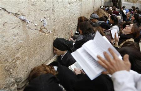 Women pray at the Western Wall in Jerusalem's Old City February 11, 2013. REUTERS/Baz Ratner/Files