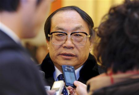 Former railways minister Liu Zhijun talks to the media during the Chinese People's Political Consultative Conference (CPPCC) in Beijing, in this picture taken March 3, 2013. REUTERS/Stringer