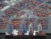 File photo of a container ship being loaded at a terminal in the harbour of Hamburg September 23, 2012. The World Trade Organization slashed its forecast for global trade growth in 2013 to 3.3 percent from 4.5 percent April 10, 2013, and said 2012 saw only a 2.0 percent increase, the smallest annual rise since records began in 1981. REUTERS/Fabian Bimmer/Files