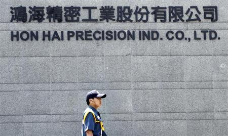 A security guard patrols at Hong Hai headquarters in Tucheng, Taipei county, June 8, 2010.REUTERS/Pichi Chuang