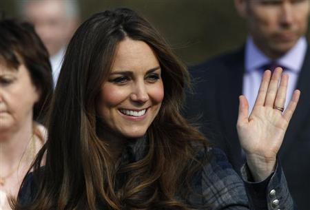 Britain's Catherine, Duchess of Cambridge waves as she leaves after visiting the Donald Dewar centre in Glasgow, Scotland April 4, 2013. REUTERS/David Moir