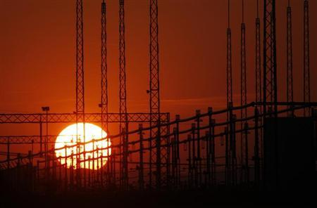 The sun sets behind a Austria Power Grid transformer in Vienna March 30, 2011. REUTERS/Lisi Niesner