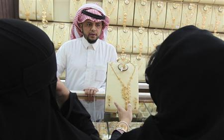 Women look at jewellery at the gold market in Riyadh, March 11, 2013. REUTERS/Stringer/Files