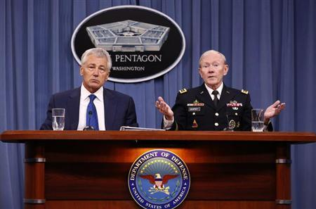 U.S. Defense Secretary Chuck Hagel (L) listens as Chairman of the Joint Chief of Staff General Martin Dempsey (R) speaks during a briefing on the Defense Department's FY2014 budget at the Pentagon in Washington April 10, 2013. REUTERS/Kevin Lamarque