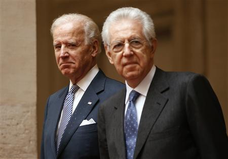 U.S. Vice President Joe Biden (L) stands next to Italy's outgoing Prime Minister Mario Monti at Chigi palace in Rome March 18, 2013. REUTERS/Tony Gentile