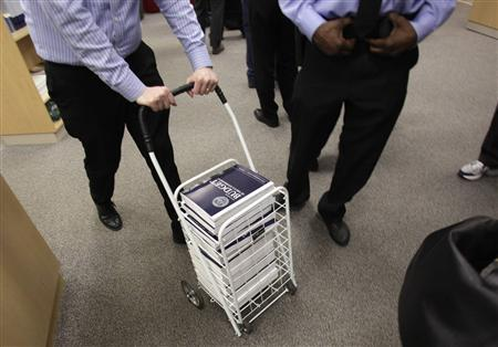 People buy copies of the Fiscal Year 2014 Budget on the first day of its release and distribution at the Government Printing Office in Washington April 10, 2013. REUTERS/Yuri Gripas