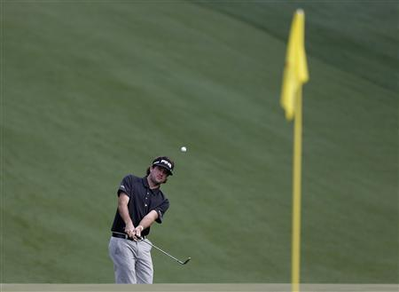 Defending champion Bubba Watson of the U.S. chips to the 10th green during a practice round in preparation for the 2013 Masters golf tournament at the Augusta National Golf Club in Augusta, Georgia, April 8, 2013. REUTERS/Phil Noble