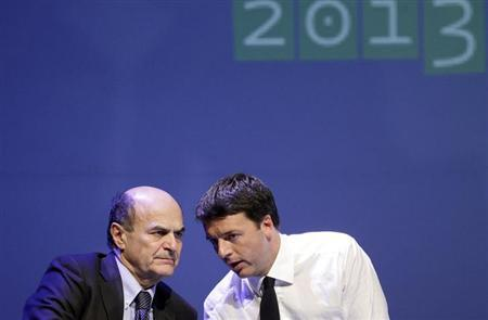 Italian PD (Democratic Party) leader Pierluigi Bersani (L) speaks with mayor of Florence Matteo Renzi during a political rally in Florence February 1, 2013. REUTERS/Max Rossi