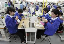 North Korean workers make shoes at a factory of a South Korean shoes company in the inter-Korean industrial park in Kaesong, North Korea, in this October 16, 2007 file photo. The hidden human face of North Korea's move to shutter an industrial park it ran with Seoul is its 53,000-strong workforce. At the Kaesong industrial zone, North Korean workers earned regular wages and formed bonds with their southern compatriots, even flirting once in a while. North Korea's most skilled labourers have kept South Korean factories at the park humming for nearly a decade, at the same time putting food on the tables of an estimated 200,000 people in one of the world's poorest countries. REUTERS/Lee Jin-man/Pool/Files