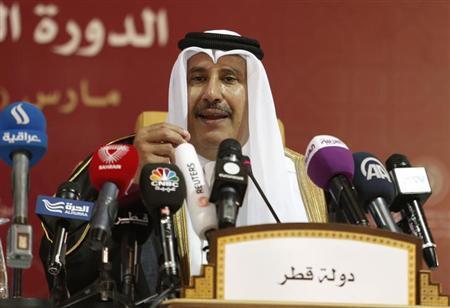 Qatari Prime Minister Sheikh Hamad bin Jassim al-Thani talks during his news conference with Arab League Secretary General Nabil al-Araby at the end of the Arab League summit in Doha, Qatar, March 26, 2013.REUTERS/Ahmed Jadallah