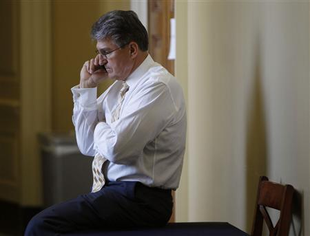 Senator Joe Manchin (D-WVA) takes a call outside a party policy luncheon on Capitol Hill in Washington April 9, 2013. REUTERS/Gary Cameron
