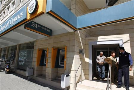 Depositors leave a branch of the Bank of Cyprus shortly after it opened in Nicosia March 28, 2013. REUTERS/Bogdan Cristel