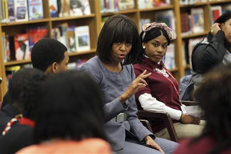 First Lady Michelle Obama is shown in this handout photo provided courtesy of the Chicago Tribune as she talks with students about the plague of violence in their area at Harper High School in the Englewood neighborhood of Chicago, Illinois April 10, 2013. REUTERS/Nancy Stone/Chicago Tribune/Handout