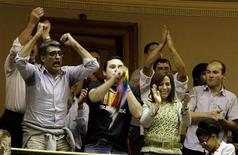 Uruguayan citizens celebrate in the Congress building after Uruguay's Congress passed a bill to allow same-sex marriages, making it the second country in predominantly Roman Catholic Latin America to do so, April 10, 2013. Seventy-one of 92 lawmakers in the lower house of Congress voted in favor of the proposal, one week after the Senate passed it by a wide majority. Leftist President Jose Mujica, a former guerrilla fighter, is expected to sign the bill into law. REUTERS/Andres Stapff