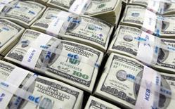 Barack Obama a promulgué mercredi le texte prévoyant un gel automatique des crédits budgétaires d'un montant de 109 milliards de dollars qui affectera la défense et d'autres programmes nationaux lors de l'année fiscale qui débute le 1er octobre. /Photo d'archives/REUTERS