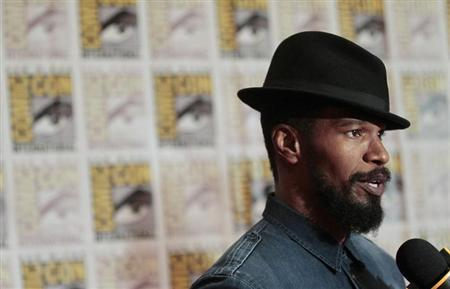 Cast member Jamie Foxx is interviewed on the red carpet for the film ''Django Unchained'' during the Comic Con International convention in San Diego, California July 14, 2012. REUTERS/Mario Anzuoni/Files