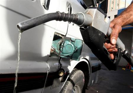 A worker fills the tank of a car at a petrol station in Cairo, March 12, 2013. REUTERS/Mohamed Abd El Ghany/Files