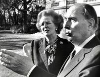 British Prime Minister Margaret Thatcher (L) talks with French President Francois Mitterrand in the garden of the Elysee Palace in Paris in this November 21, 1986 file picture. REUTERS/Pool