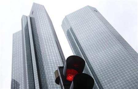 The headquarters of Germany's largest business bank, Deutsche Bank are seen behind a red traffic light in Frankfurt January 30, 2013. REUTERS/Kai Pfaffenbach