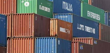 Shipping containers are shown stacked at the Port of Los Angeles in San Pedro, California August 31, 2010. REUTERS/Fred Prouser