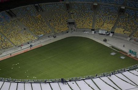 An aerial view shows the seats and final touches of the roof installation at the Maracana Stadium, which is undergoing renovation for the 2014 World Cup, in Rio de Janeiro April 9, 2013. REUTERS/Ricardo Moraes