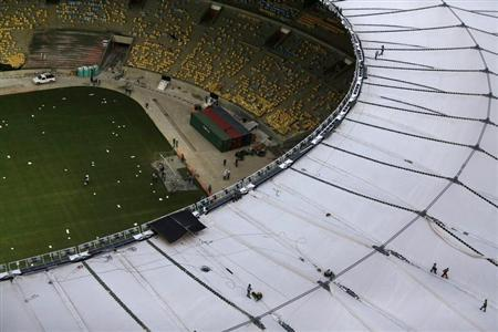 An aerial view shows the final touches of the roof installation at the Maracana Stadium, which is undergoing renovation for the 2014 World Cup, in Rio de Janeiro April 9, 2013. REUTERS/Ricardo Moraes