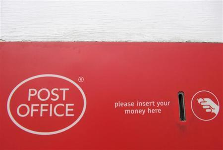 A Post Office services sign is seen outside a branch in central London November 9, 2010. REUTERS/Toby Melville