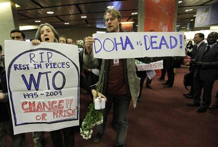 Activists of various NGO's demonstrate against the Doha Round global trade talks inside the Geneva International Conference Center (CICG) before the closing ceremony of the 7th World Trade Organisation (WTO) ministerial meeting in Geneva December 2, 2009. REUTERS/Denis Balibouse/Files