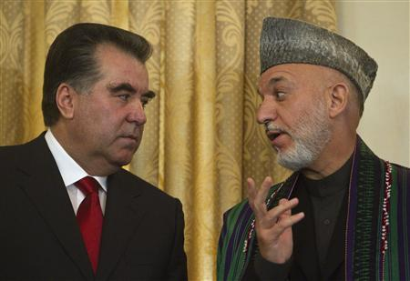 Afghan President Hamid Karzai (R) speaks with his Tajik counterpart Imomali Rakhmon in Kabul October 25, 2010. REUTERS/Ahmad Masood