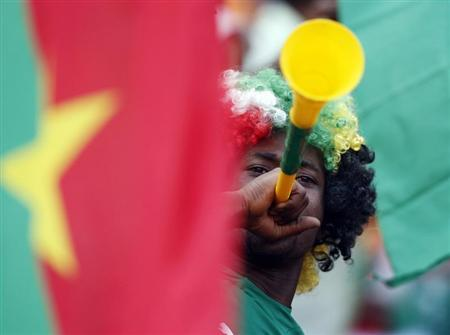 A Burkina Faso soccer fan blows a vuvuzela ahead of the African Nations Cup (AFCON 2013) final soccer match between Burkina Faso and Nigeria in Johannesburg February 10, 2013. REUTERS/Mike Hutchings