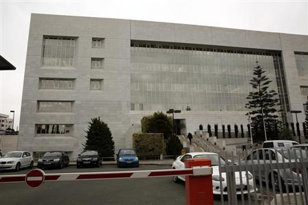 A man enters the Central Bank of Cyprus in Nicosia February 22, 2013. REUTERS/Yorgos Karahalis