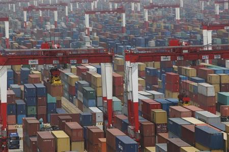 A general view of a shipping container area at the Yangshan Port of Shanghai May 11, 2012. REUTERS/Aly Song