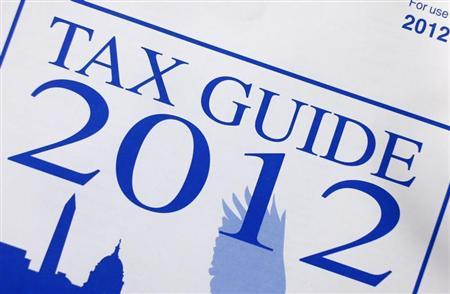 A 2012 tax guide for individuals issued by the Internal Revenue Service is seen in New York March 18, 2013. REUTERS/Shannon Stapleton